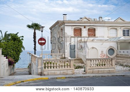 Ruined house at seaside in Santa Pola town. It is a coastal town located in the comarca of Baix Vinalopo in the Valencian Community Alicante Spain by the Mediterranean Sea.