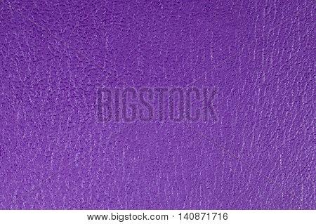 Purple embossed decorative leatherette texture background, close up