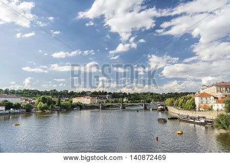 PRAGUE, CZECH REPUBLIC, JULY 5,2016: Vltava river and (Josef) Manes Bridge,the first bridge downstream of the famous Charles Bridge, was in 1920 renamed in the painter's honour