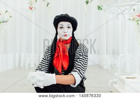 Portrait Of Young Mime Girl With Black Hat