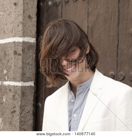 Teenage Model Struggling With His Long Hair