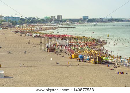 Mamaia Romania - July 18 2016:People enjoying on beach in Mamaia Mamaia is the best known resort on Romanian Riviera.It's situated on 8km long and 300m wide sandy land at the Black Sea.
