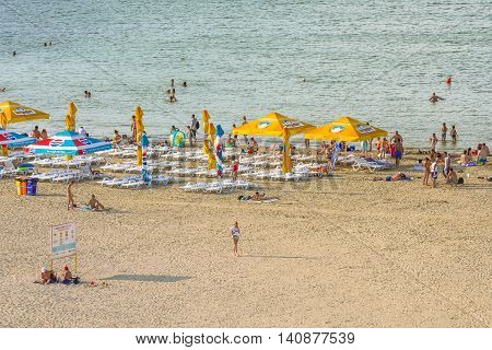 Mamaia Romania - July 18 2016:Group of tourists enjoying on beach in MamaiaMamaia is the best known resort on Romanian Riviera.It's situated on 8km long and 300m wide sandy land at the Black Sea.