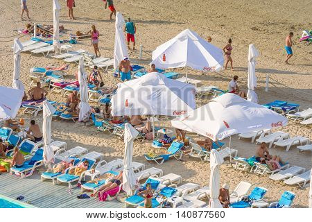 Mamaia Romania - July 18 2016: People having fun on beach in MamaiaMamaia is the best known resort on Romanian Riviera.It's situated on 8km long and 300m wide sandy land at the Black Sea.