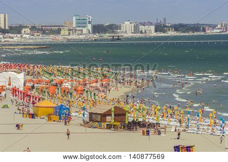 Mamaia Romania - July 18 2016: People enjoying on beach in Mamaia Mamaia is the best known resort on Romanian Riviera.It's situated on 8km long and 300m wide sandy land at the Black Sea.