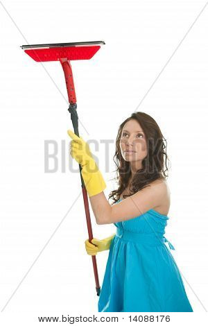 Cheerful woman cleaning window