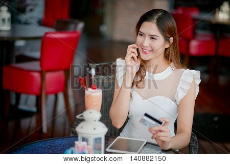 The Online Payment, Girl 's Hands Holding A Credit Card And Using Smart Phone For Online Shopping