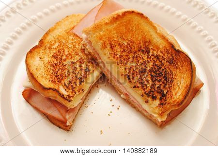 Grilled Ham and Cheese Sandwich Cut in Half Served on a Plate