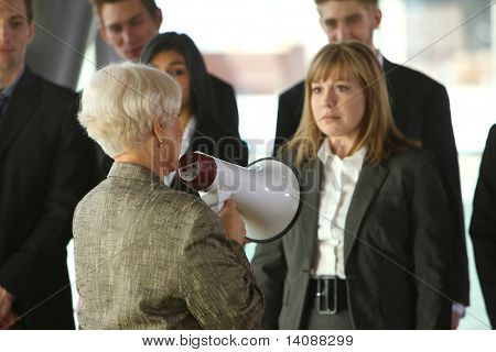 Boss yelling at employees with megaphone