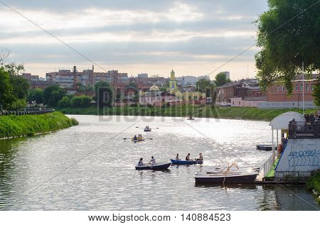 KHARKIV UKRAINE - JUNE 18 2016: View on the river Lopan quay with boats and the main muslim mosque of the city