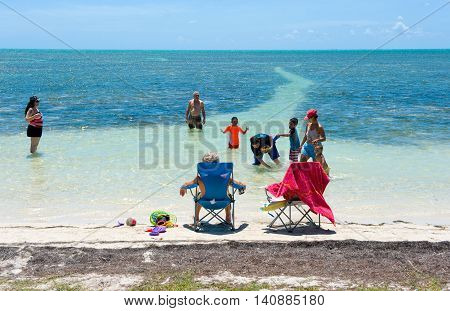 FLORIDA KEYS USA - MAY 01 2016: A family is relaxing and swimming on the beach of one of the Florida Keys.