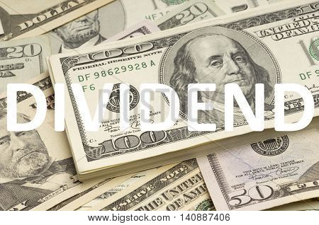US Dollars with dividend written on it