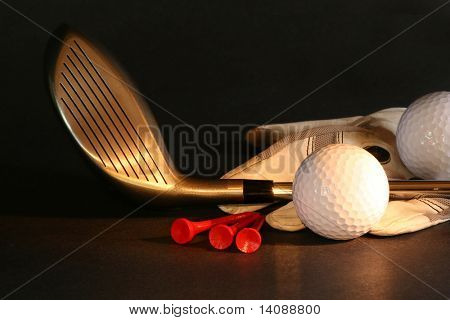 Golf essentials on black background