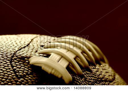 Close-up of the stitches on a Football/ soft focus