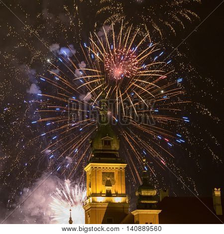 Fireworks cracking over the old town of Warsaw Poland