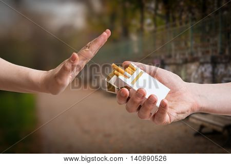 Quitting Smoking Concept. Hand Is Rejecting Cigarette Offer.