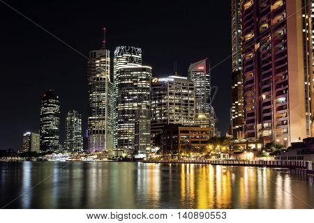 BRISBANE, AUSTRALIA - AUGUST 1 2016: Brisbane cityscape by night on the City Reach Boardwalk - closeup
