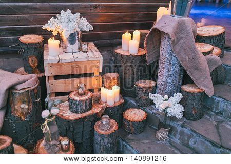 Rustic wedding decor, decorated stairs with sumps and lilac arrangements.