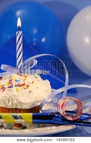 Festive decorations for small party cake with blue candle