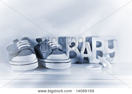 Little baby denim running shoes with pacifier on shelf