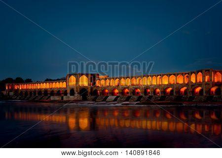 Khaju Bridge at night in the province of Isfahan Iran.