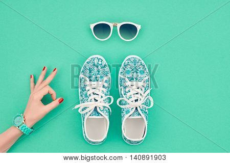 Fashion. Clothes Accessories fashion Set. Female hand OK Gesture and Stylish Trendy gumshoes, Glamor Sunglasses. Summer fashion girl Outfit, accessories. Hipster Essentials. Minimal fashion style