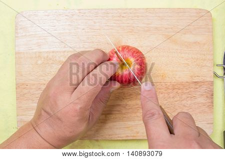 chef cutting apple before cooking / cooking steak concept