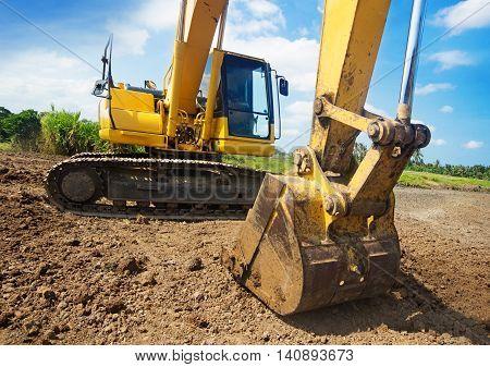 Excavator machine working at construction site  п