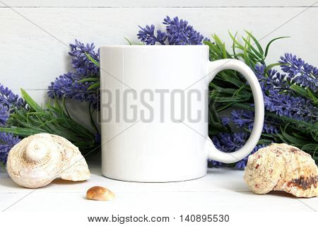 Mock-up of a white mug with lavender and seashells.