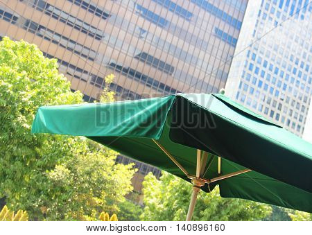green umbrella in a cafe in the city center