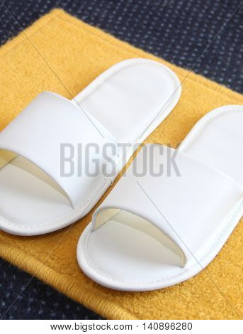 white slippers on carpet background In a hotel