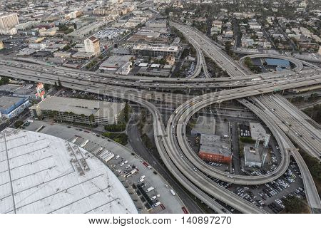 Los Angeles, California, USA - July 21, 2016:  After sunset aerial of the Santa Monica 10 and Harbor 110 freeway interchange near downtown Los Angeles.