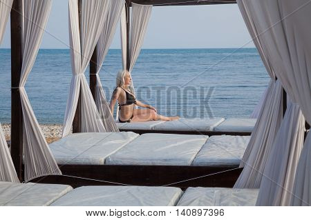 girl in bathing suit sunning on the beach