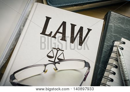 Law book amd glasses. Legislation and justice concept.