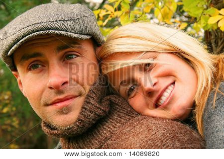 Young couple in love and having some autumn fun