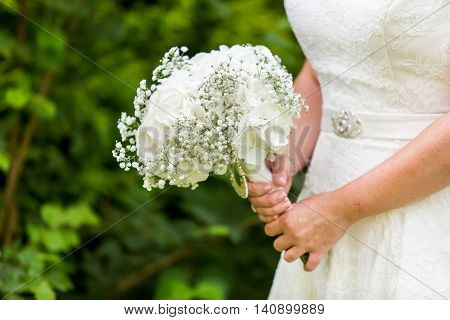 Bride holding Hydrangea, Gypsophila bouquet. Wedding flowers. Bridal white flowers bouquet. Wedding.