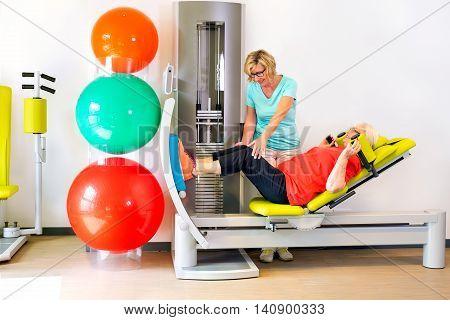 Therapist Helps Woman Strengthen Leg Muscles