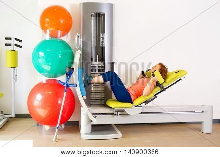 Crutches Leaning On Machine That Woman Is Using
