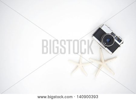 Vintage photo camera with sea animal on wood white