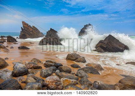 Ocean beach landscape - Big waves breaking on the shore with rocks, Portugal, European travel