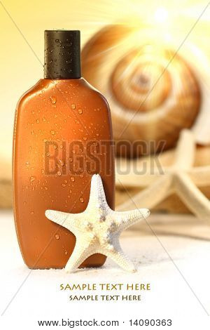Suntan lotion and seashells with sunny  background