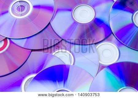 Many Compact Discs scattered seen from above