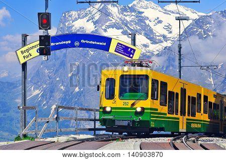 Kleine Scheidegg Switzerland - June 11 2010: Passenger train approach to the platform.