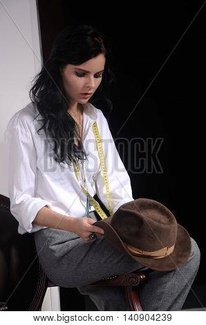Portrait Of A Girl Dressmaker At Work.