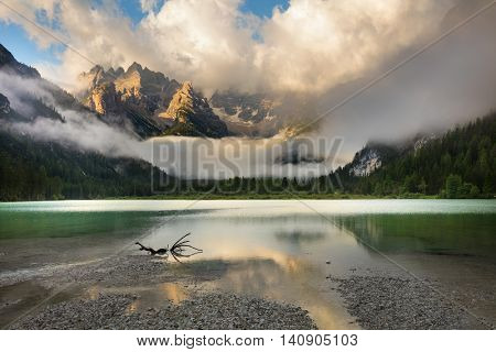 Mountains Lake at misty foggy morning. Beautiful Nature Landscape. Lago di Landro Durrensee, Dolomites, Alps, Italy, Europe.