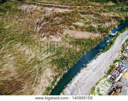 landscape with field, river and dump, top view, aerial photo
