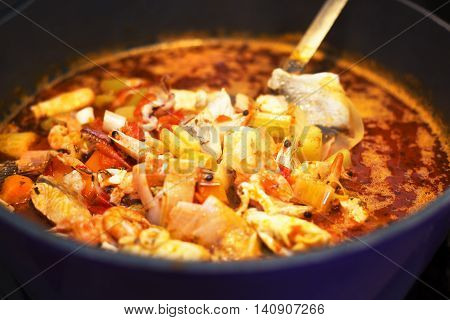 Seafood soup bouillabaisse in pot. French cuisine