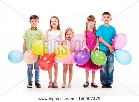 cute children celebrating birthday with decorations