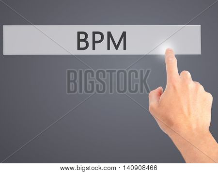 Bpm (business Process Management) - Hand Pressing A Button On Blurred Background Concept On Visual S