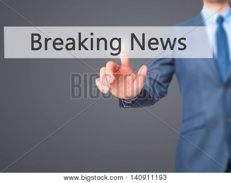 Breaking News - Businessman Hand Touch  Button On Virtual  Screen Interface